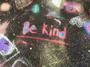 """""""Be kind"""" written in chalk on the sidewalk"""