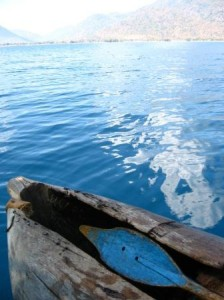 Hollow canoe and blue water of Lake Malawi